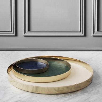 GamFratesi designs leather-lined brass trays for Skultuna