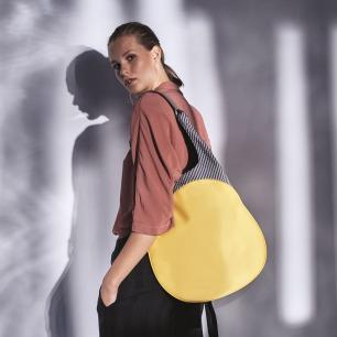 明星同款袋鼠手提单肩包 | 特色圆形设计 独特印花
